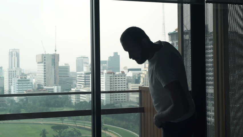 Young businessman dressing, preparing for work by window at home, timelapse  | Shutterstock HD Video #22559068