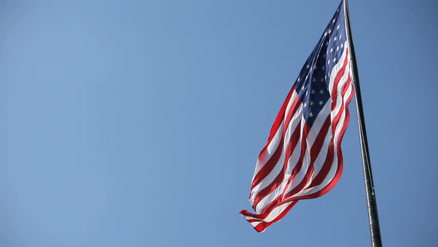 looking at flag pole with American flag waving - HD stock video clip