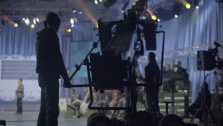 KYIV, UKRAINE – APRIL 13, 2016. Man operating a crane with the camera in TV Studio | Shutterstock HD Video #22682278