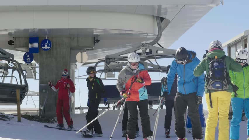 Ajax, France, 2013 dec: Skiers who came with chairlift on the piste and is now preparing to descend the slopes of the mountain slanted 33  | Shutterstock HD Video #22705210