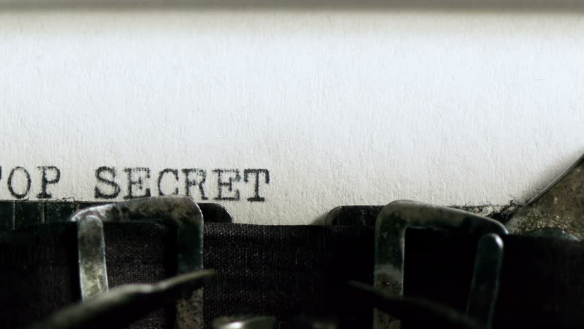 Typing TOP SECRET (HD). TOP SECRET being typed and centered on Vintage 1940s typewriter. Ambient audio Included.