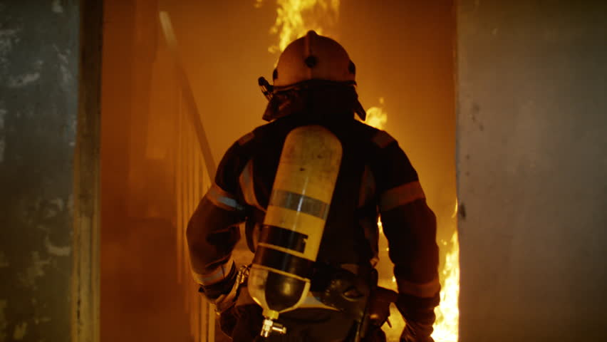 Two Brave Firefighters Go Up Burning Stairs. They Go Through Open Doors. Building is on Fire. Open Flames and Smoke Everywhere. Slow Motion.Shot on RED EPIC 4K (UHD).