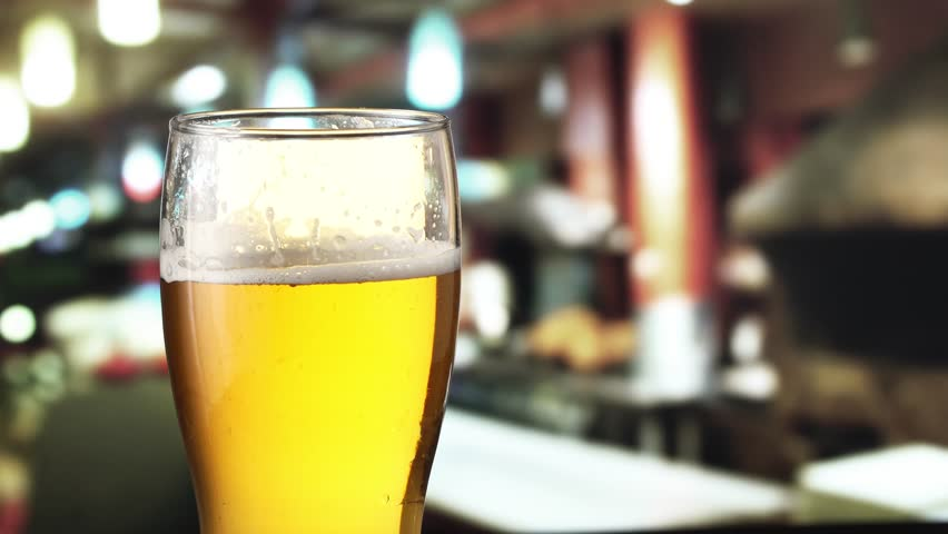 Beer is pouring from the top into the glass. 4K video. | Shutterstock HD Video #22811734