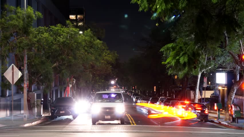 Timelapse of a busy city intersection during the night. | Shutterstock HD Video #22837213