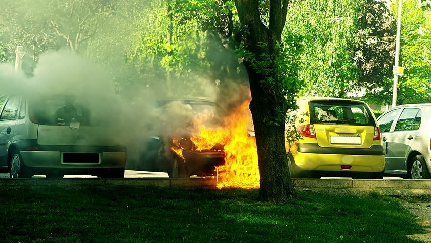 Car engulfed in flames.