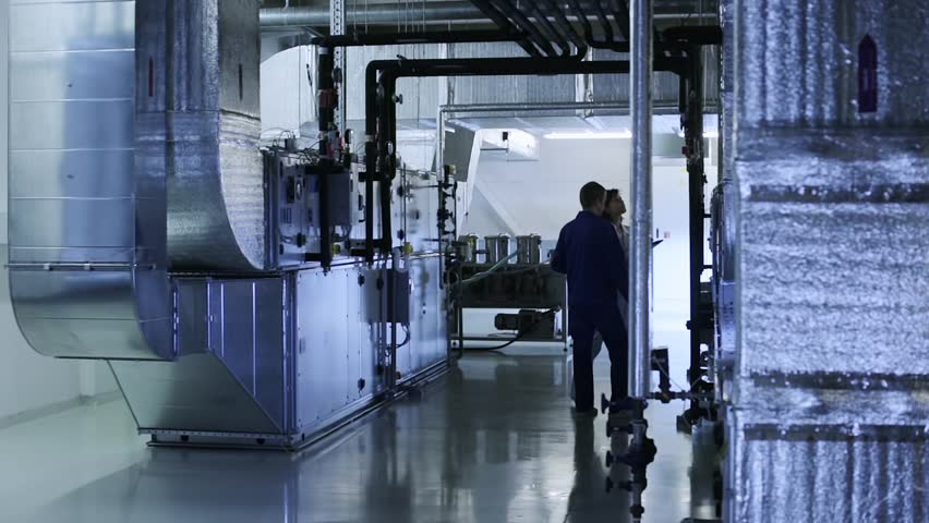 People checks industrial air ducts of a ventilation system on clean and light technical floor | Shutterstock HD Video #22895506