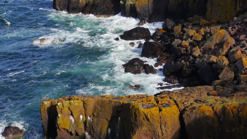 Summer. 2015  - The North Sea washing the rocks at St. Abbs Head Natural Nature Reserve, Scotland, UK.  | Shutterstock HD Video #22918537