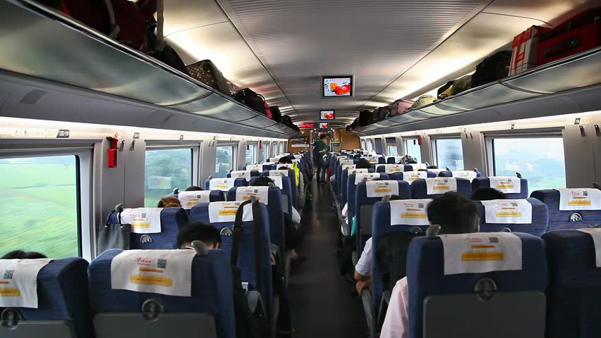 BEIJING, CHINA - SEPTEMBER 27, 2014: Passengers inside of a bullet train on September 27, 2014 in Beijing, China | Shutterstock HD Video #22971574