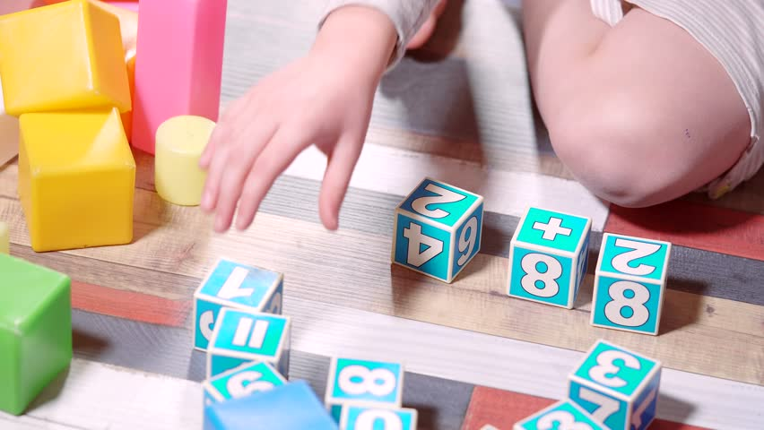 Colorful cubes. Child plays in mathematics. Learning through play. | Shutterstock HD Video #23035492