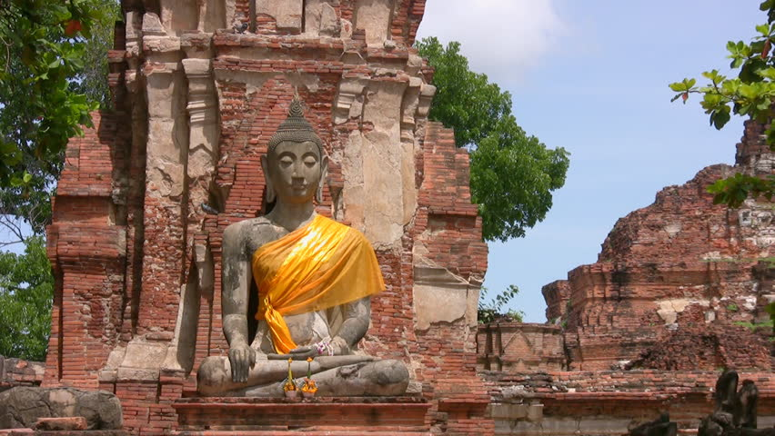 A Buddha image in a ruined temple in Ayuthaya, the former capital of Thailand, and now a World Heritage Area. Canon HV20, HD 1080-50i. - HD stock footage clip