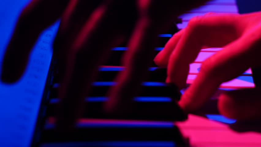 Two hands Playing on the Colored Piano Dolly Shot - 4K stock video clip
