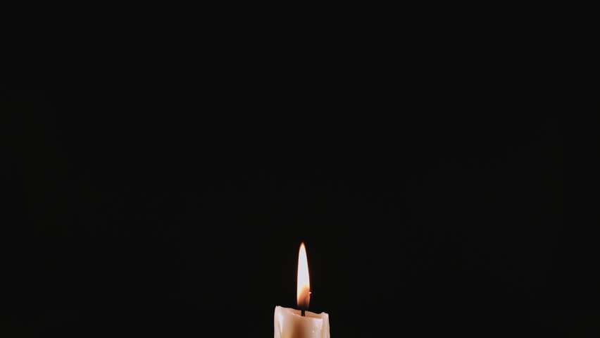 Extinguished candle with smoke on black background | Shutterstock HD Video #23058163
