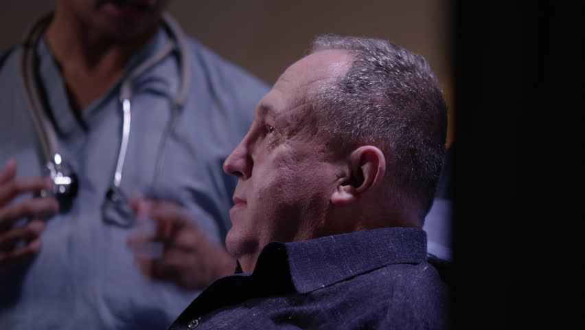 Doctor checking senior man's heart | Shutterstock HD Video #23058865