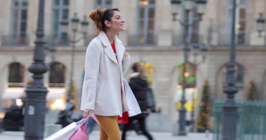 Paris, Woman shopping in Paris on place Vendome, 4K, UHD (3840X2160) | Shutterstock HD Video #23074489