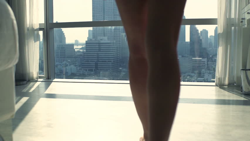 Young, sexy woman admire view from window at home, super slow motion 120fps    Shutterstock HD Video #23091211