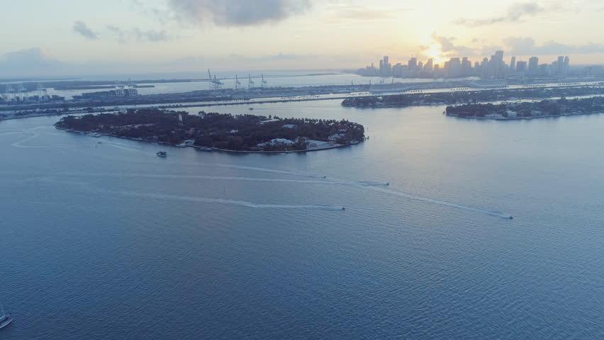 Aerial Landscape of Jet Skis Speeding Across Biscayne Bay Miami Florida   Shutterstock HD Video #23106700