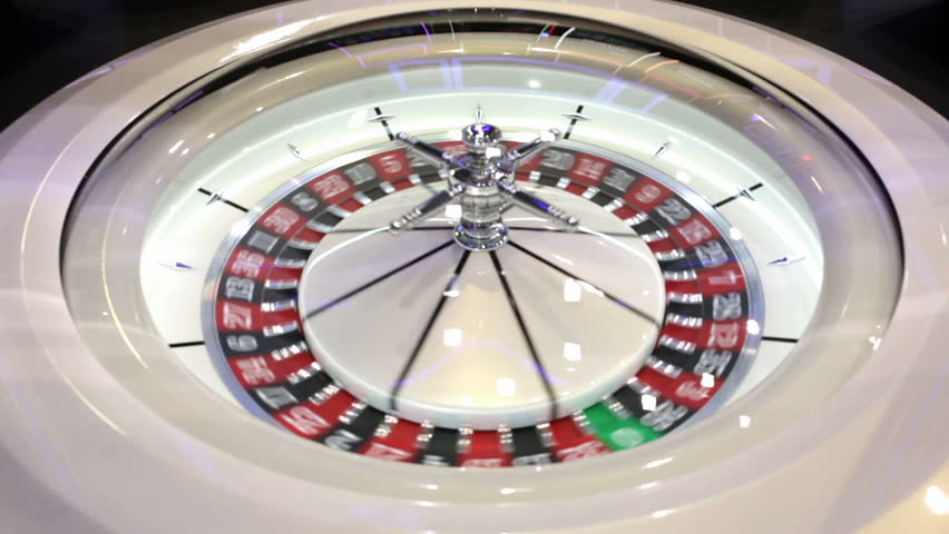 Modern roulette table in casino. Ball in the rotating gambling machine. Colourful roulette wheel. | Shutterstock HD Video #23122945