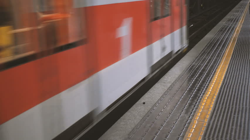 Train arriving at an underground station and people waiting   Shutterstock HD Video #23126581