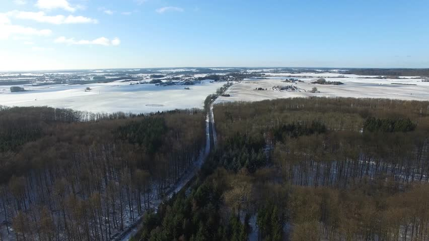 Aerial view fly over a road in snowy winter forest landscape - dronen flight | Shutterstock HD Video #23134294
