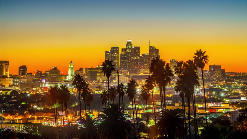 Twilight to night transition city of Los Angeles downtown skyline palm trees in foreground. 4K UHD timelapse. | Shutterstock HD Video #23151448