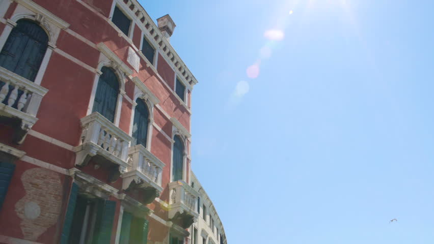 Bright sun shining in blue sky over old Baroque buildings, travel to Venice | Shutterstock HD Video #23157829