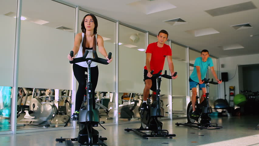 Young sports people cycling in the gym on the exercise bike | Shutterstock HD Video #23162032