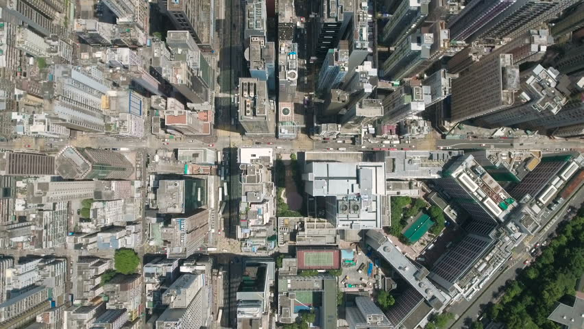 Abstract aerial drone footage of rooftops and streets in the densely populated Kowloon area in Hong Kong, one of Asia's most iconic modern cities.    Shutterstock HD Video #23168224