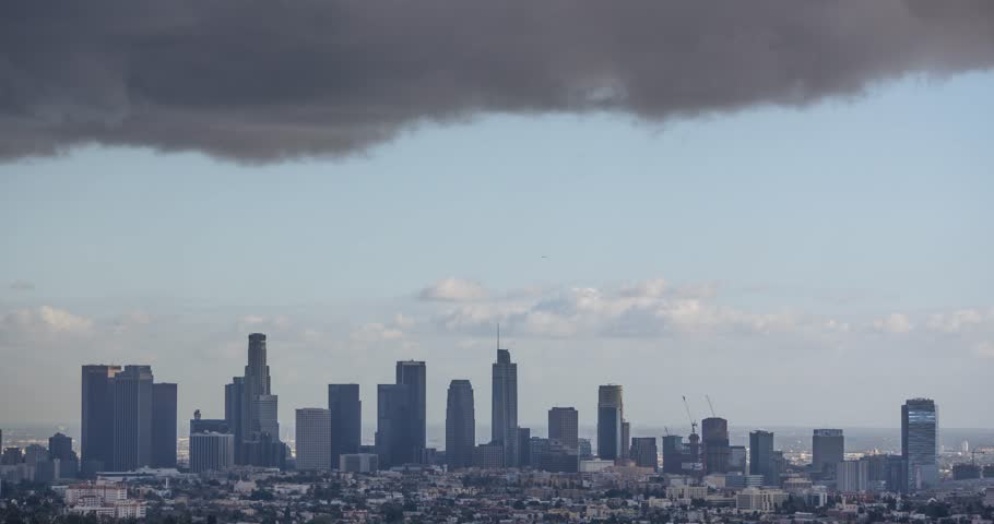 A time lapse shot from a mountain looking at downtown Los Angeles skyline with grey clouds passing quickly | Shutterstock HD Video #23172238