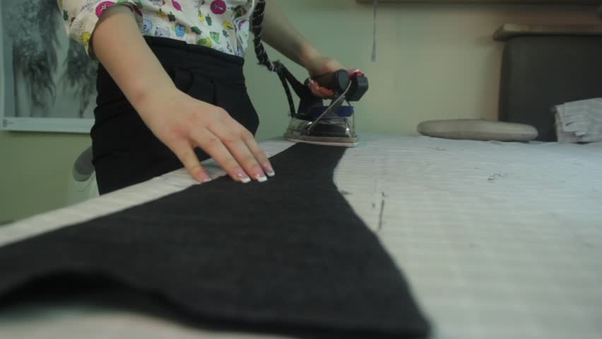 Iron the handle fabric in a factory sewing clothes   Shutterstock HD Video #23175460
