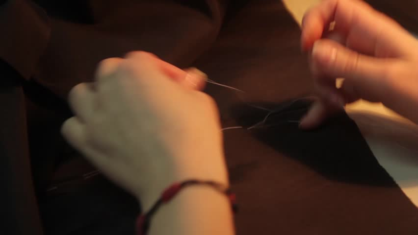 Hands of a seamstress at work   Shutterstock HD Video #23175469