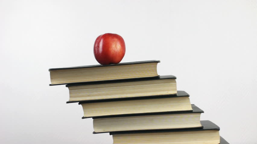 Books and red apple as symbol of education, knowledge and wisdom. | Shutterstock HD Video #23175586