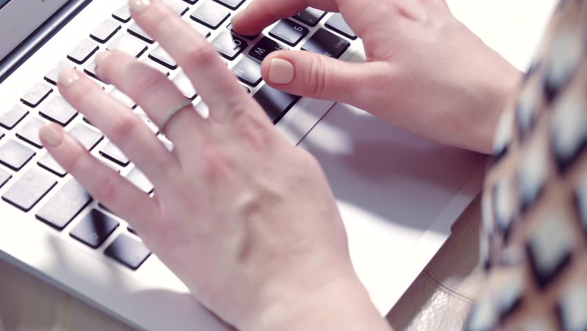 The girl's hands working on the keyboard of a laptop computer | Shutterstock HD Video #23179447