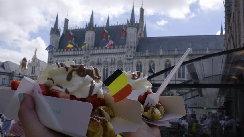 Closeup Of Travel Buddies Holding Up Their Specialty Belgian Waffles In Bruges, Belgium | Shutterstock HD Video #23179663