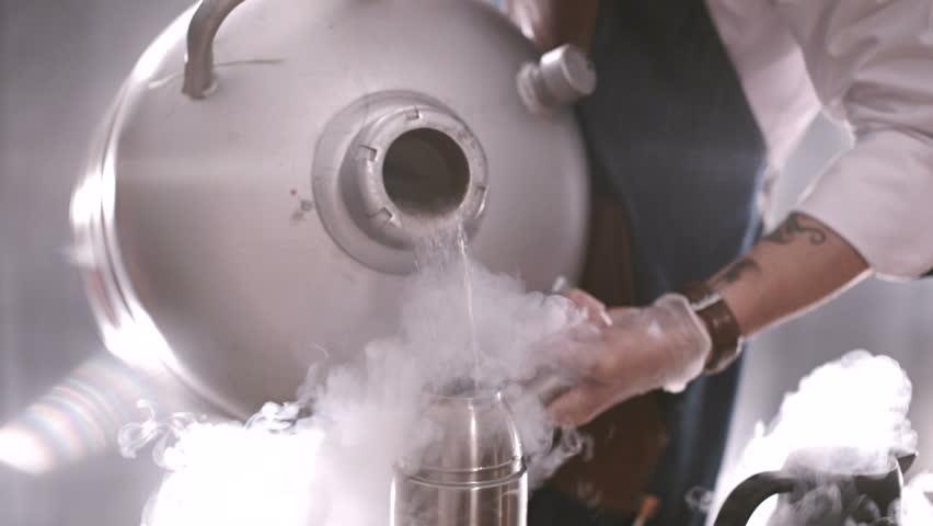 Chef pours liquid nitrogen. catering food art show | Shutterstock HD Video #23180302