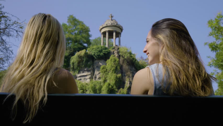 Friends Sit On A Bench And Enjoy The Temple De La Sibylle In The Parc Des Butte Chaumont In Paris, France | Shutterstock HD Video #23180887