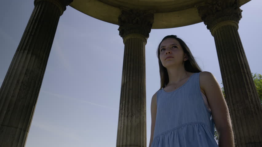 Closeup Of Beautiful Young Woman Enjoying The View From The Temple De La Sibylle In The Parc Des Butte Chaumont In Paris, France | Shutterstock HD Video #23180896