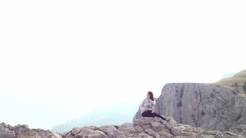 Young woman hiker use digital tablet taking photo at mountain peak cliff. Young hipster traveler | Shutterstock HD Video #23182795