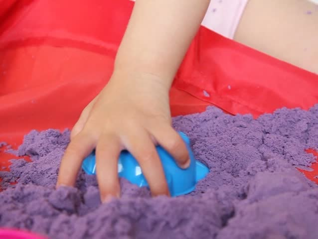 Toddler playing with Purple kinetic sand Close-up | Shutterstock HD Video #23186503