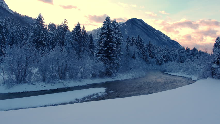 Aerial, edited - Beautiful wintry sunset with a mountain, river and pine forest | Shutterstock HD Video #23192083
