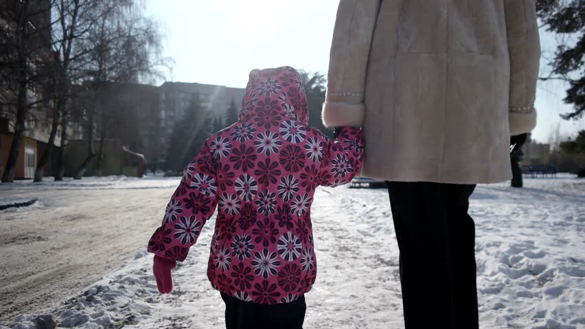 3 Year Old Girl Walking With Her Mother by Snow-Covered Embankment Alley in Winter . Steadicam Shot | Shutterstock HD Video #23194189