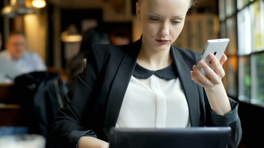 Busy businesswoman working on modern technologies in the cafe, steadycam shot    Shutterstock HD Video #23199103