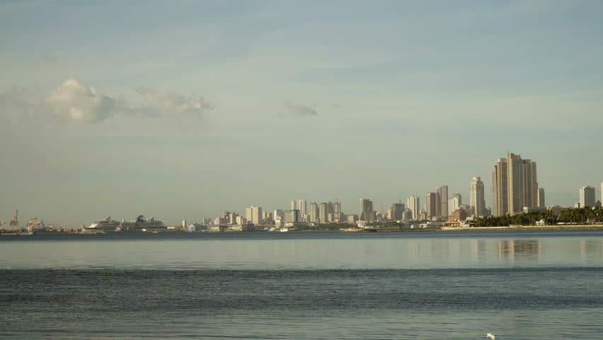 Manila city, skyscrapers and buildings. Seascape coastal city of Manila. Modern city by sea. Makati district. 4K video. Travel concept. | Shutterstock HD Video #23207005