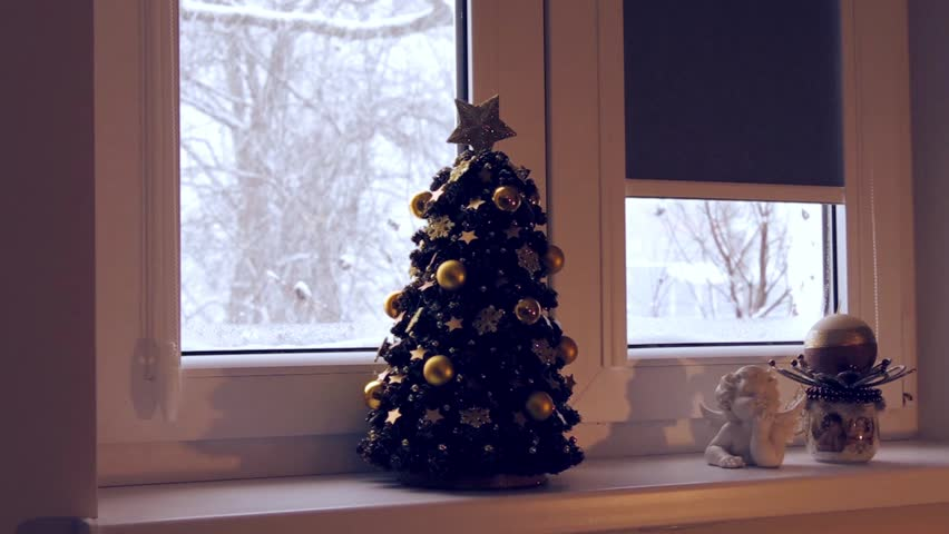 Christmas time, Christmas tree, snow falling outside the window. | Shutterstock HD Video #23207284