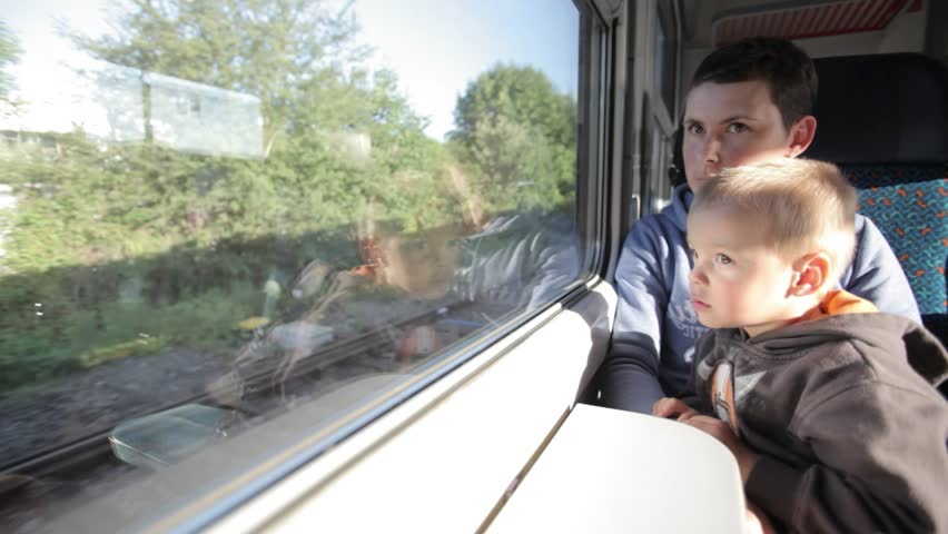 Young family travels by train. Cute, little boy travels by train with her mother. | Shutterstock HD Video #23208949