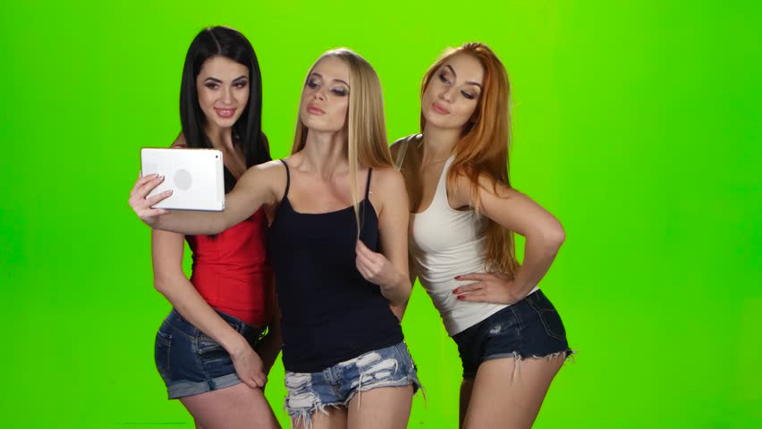 Girls pose for the camera of the tablet. Green screen | Shutterstock HD Video #23210326