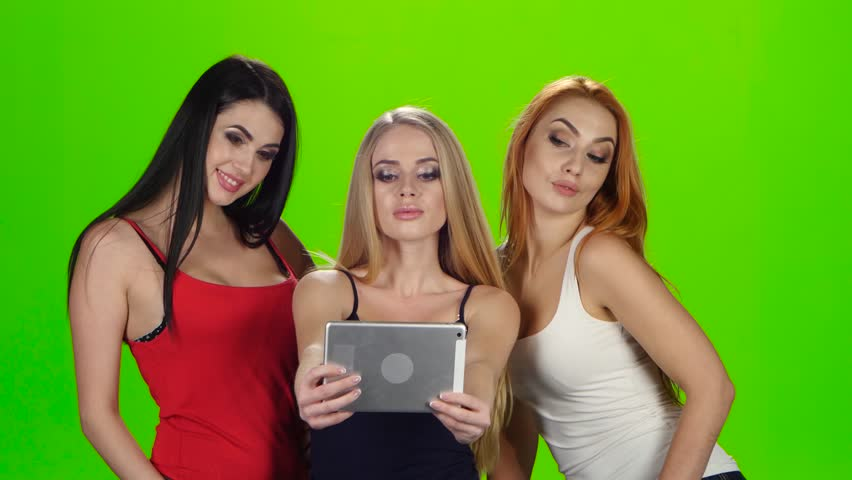 Green screen. Girls pose for the camera of the tablet | Shutterstock HD Video #23210398