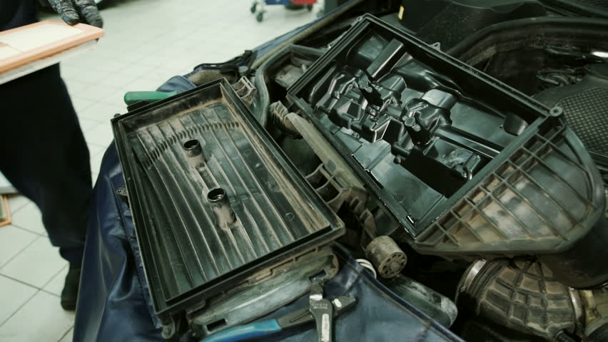 In service station mechanic installs a new air filter inside the box. | Shutterstock HD Video #23212279