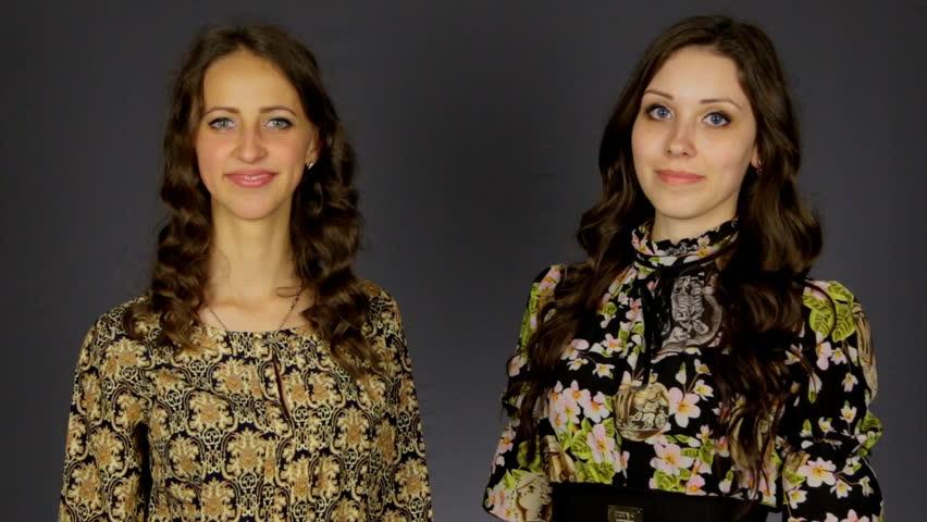 Two beautiful girls show thumb good,   Shutterstock HD Video #23213233