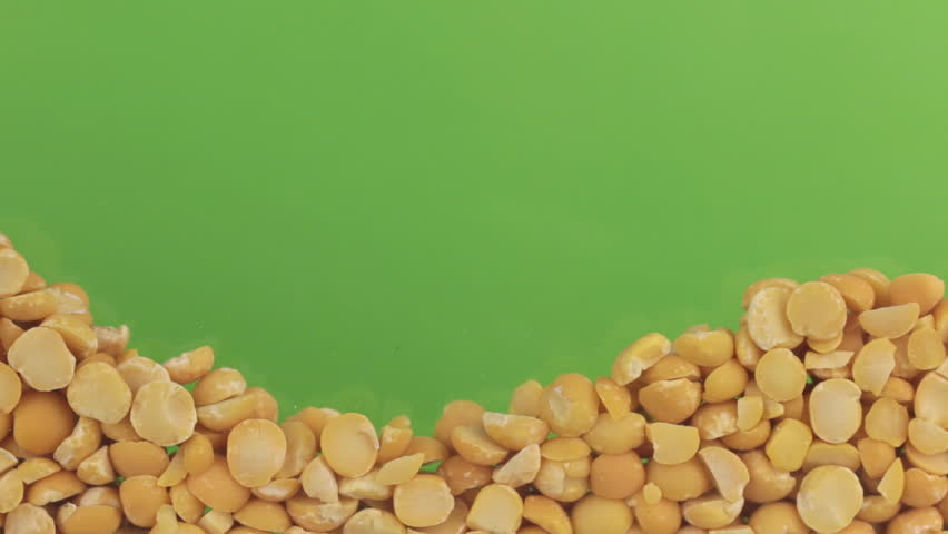Dry pea grains close the (to bury) green screen. | Shutterstock HD Video #23213287