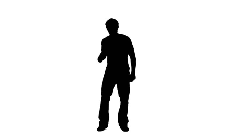 A silhouette of a man causally dancing against a white background - HD stock video clip